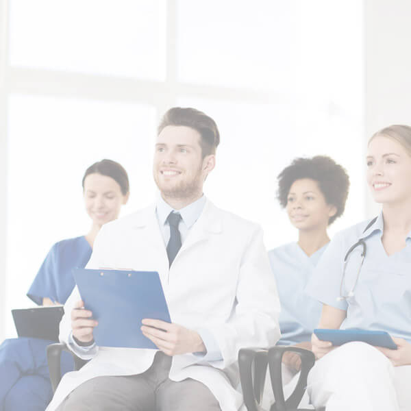 Doctors and Nurses sitting with clipboards